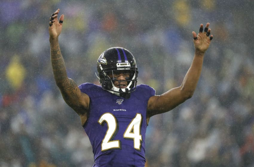BALTIMORE, MARYLAND - DECEMBER 29: Cornerback Marcus Peters #24 of the Baltimore Ravens acknowledges the crowd against the Pittsburgh Steelers during the first quarter at M&T Bank Stadium on December 29, 2019 in Baltimore, Maryland. (Photo by Scott Taetsch/Getty Images)
