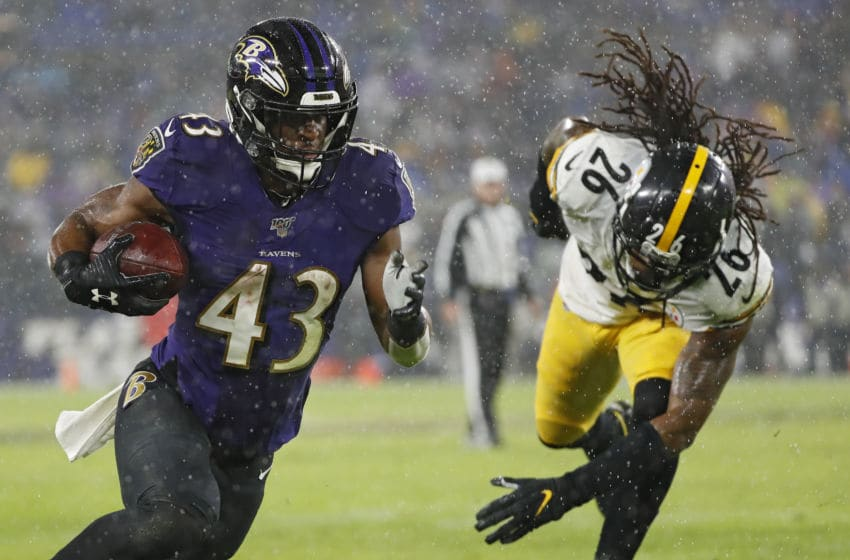 BALTIMORE, MARYLAND - DECEMBER 29: Running back Justice Hill #43 of the Baltimore Ravens rushes past inside linebacker Mark Barron #26 of the Pittsburgh Steelers during the second quarter at M&T Bank Stadium on December 29, 2019 in Baltimore, Maryland. (Photo by Scott Taetsch/Getty Images)