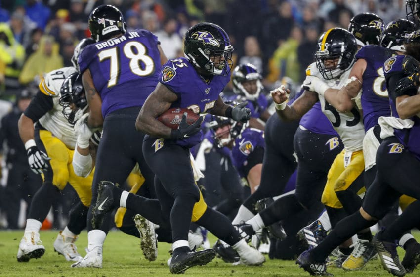 BALTIMORE, MD - DECEMBER 29: Gus Edwards #35 of the Baltimore Ravens carries the ball against the Pittsburgh Steelers during the first half at M&T Bank Stadium on December 29, 2019 in Baltimore, Maryland. (Photo by Scott Taetsch/Getty Images)