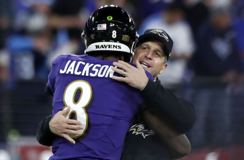 BALTIMORE, MARYLAND - JANUARY 11: Head coach John Harbaugh of the Baltimore Ravens and quarterback Lamar Jackson #8 embrace prior to the AFC Divisional Playoff game against the Tennessee Titans at M&T Bank Stadium on January 11, 2020 in Baltimore, Maryland. (Photo by Todd Olszewski/Getty Images)