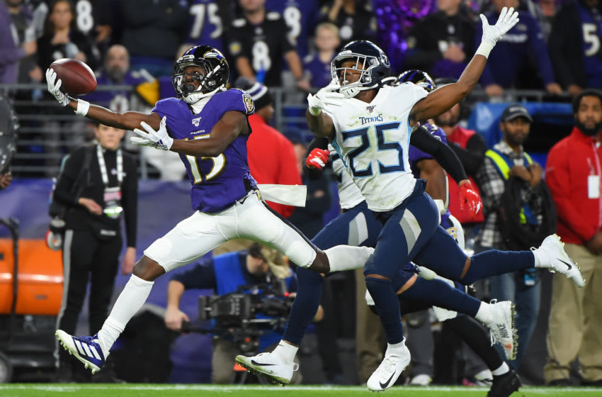 BALTIMORE, MARYLAND - JANUARY 11: Marquise Brown #15 of the Baltimore Ravens catches a deep pass over Adoree' Jackson #25 of the Tennessee Titans in the second quarter of the AFC Divisional Playoff game at M&T Bank Stadium on January 11, 2020 in Baltimore, Maryland. (Photo by Will Newton/Getty Images)