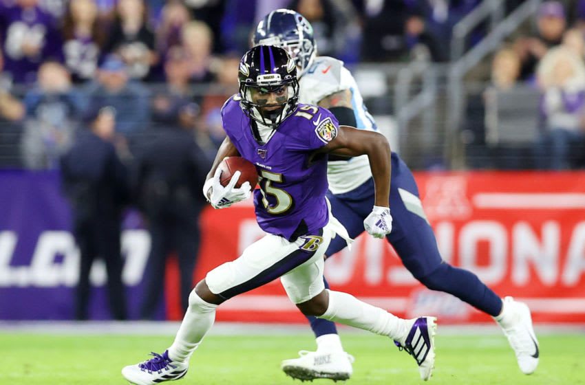 BALTIMORE, MARYLAND - JANUARY 11: Marquise Brown #15 of the Baltimore Ravens runs with the ball during the first half against the Tennessee Titans in the AFC Divisional Playoff game at M&T Bank Stadium on January 11, 2020 in Baltimore, Maryland. (Photo by Rob Carr/Getty Images)