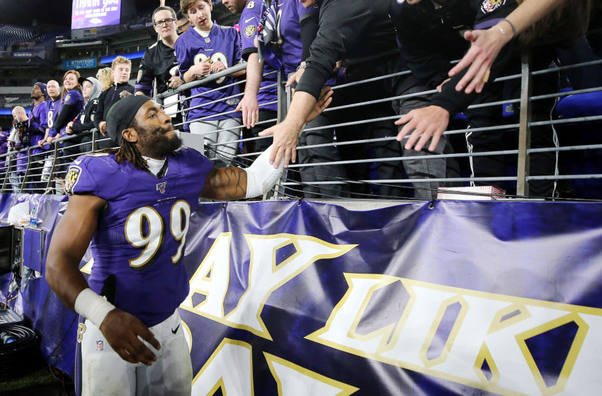 BALTIMORE, MARYLAND - JANUARY 11: Matthew Judon #99 of the Baltimore Ravens high fives fans after the AFC Divisional Playoff game against the Tennessee Titans at M&T Bank Stadium on January 11, 2020 in Baltimore, Maryland. (Photo by Maddie Meyer/Getty Images)