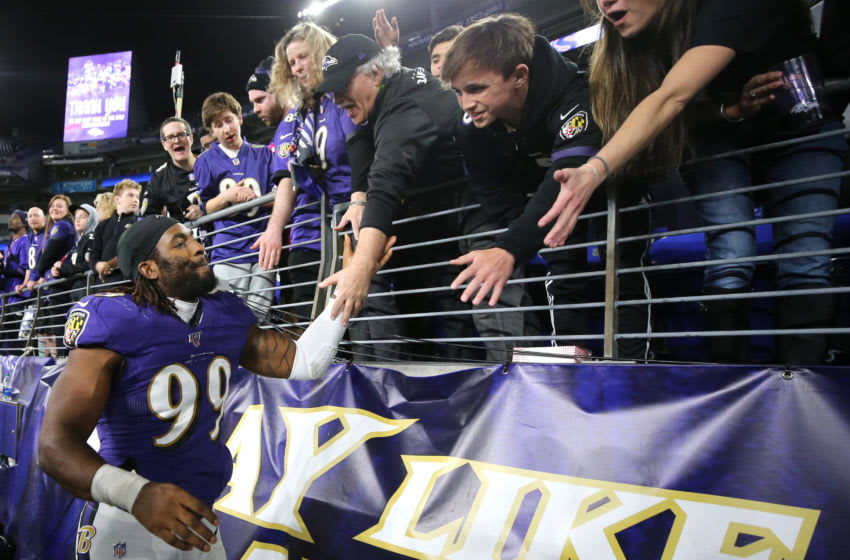BALTIMORE, MARYLAND - JANUARY 11: Matt Judon #99 of the Baltimore Ravens with fans after the AFC Divisional Playoff game against the Tennessee Titans at M&T Bank Stadium on January 11, 2020 in Baltimore, Maryland. (Photo by Maddie Meyer/Getty Images)