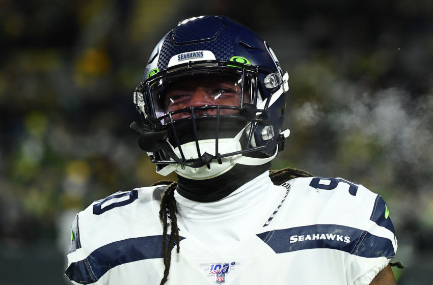 GREEN BAY, WISCONSIN - JANUARY 12: Jadeveon Clowney #90 of the Seattle Seahawks looks on before the NFC Divisional Playoff game against the Green Bay Packers at Lambeau Field on January 12, 2020 in Green Bay, Wisconsin. (Photo by Stacy Revere/Getty Images)