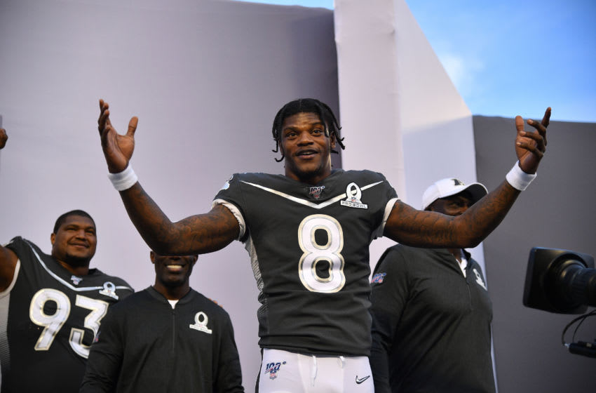 ORLANDO, FLORIDA - JANUARY 26: Lamar Jackson #8 of the Baltimore Ravens reacts to winning MVP Trophy after the 2020 NFL Pro Bowl at Camping World Stadium on January 26, 2020 in Orlando, Florida. (Photo by Mark Brown/Getty Images)