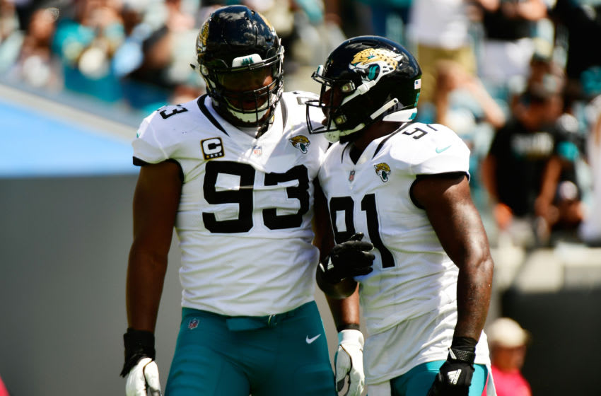 JACKSONVILLE, FL - SEPTEMBER 23: Calais Campbell #93 and Yannick Ngakoue #91 of the Jacksonville Jaguars celebrate a sack during their game against the Tennessee Titans at TIAA Bank Field on September 23, 2018 in Jacksonville, Florida. (Photo by Julio Aguilar/Getty Images)