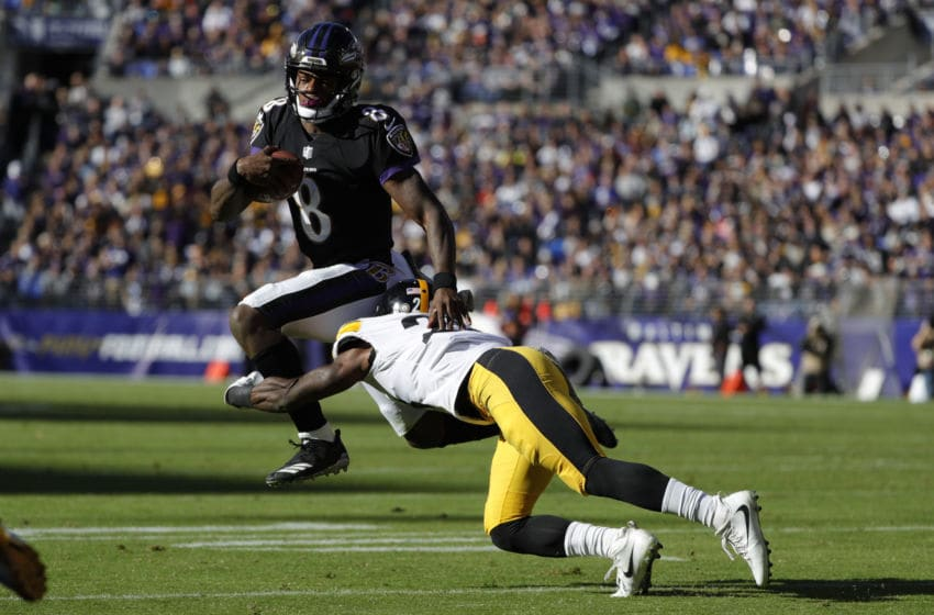 BALTIMORE, MD - NOVEMBER 04: Quarterback Lamar Jackson #8 of the Baltimore Ravens is tackled as he carries the ball by cornerback Mike Hilton #28 of the Pittsburgh Steelers in the second quarter at M&T Bank Stadium on November 4, 2018 in Baltimore, Maryland. (Photo by Scott Taetsch/Getty Images)