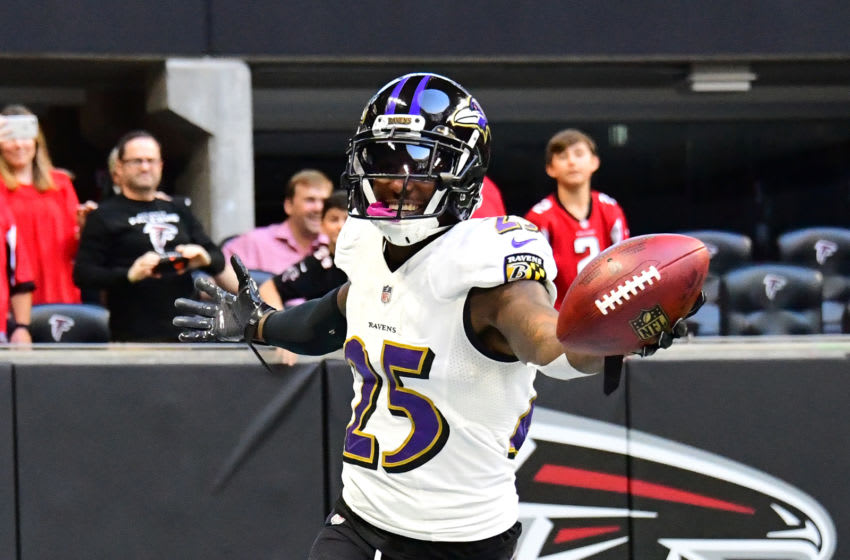 ATLANTA, GA - DECEMBER 2: Tavon Young #25 of the Baltimore Ravens celebrates after scoring a fourth quarter touchdown against the Atlanta Falcons at Mercedes-Benz Stadium on December 2, 2018 in Atlanta, Georgia. (Photo by Scott Cunningham/Getty Images)