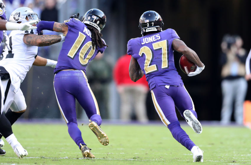 BALTIMORE, MARYLAND - NOVEMBER 25: Cornerback Cyrus Jones #27 of the Baltimore Ravens returns a punt for a touchdown in the second quarter against the Oakland Raiders at M&T Bank Stadium on November 25, 2018 in Baltimore, Maryland. (Photo by Patrick Smith/Getty Images)