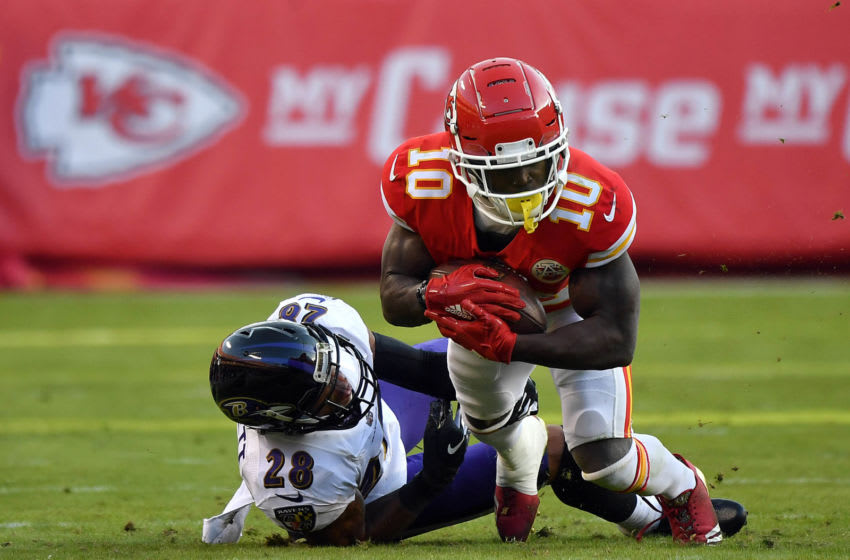 KANSAS CITY, MISSOURI - DECEMBER 09: Wide receiver Tyreek Hill #10 of the Kansas City Chiefs makes a catch as cornerback Anthony Averett #28 of the Baltimore Ravens defends during the game at Arrowhead Stadium on December 09, 2018 in Kansas City, Missouri. (Photo by Peter Aiken/Getty Images)
