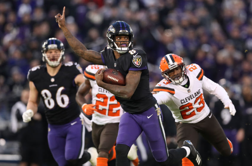 BALTIMORE, MARYLAND - DECEMBER 30: Quarterback Lamar Jackson #8 of the Baltimore Ravens runs for a touchdown in the first quarter against the Cleveland Browns at M&T Bank Stadium on December 30, 2018 in Baltimore, Maryland. (Photo by Rob Carr/Getty Images)