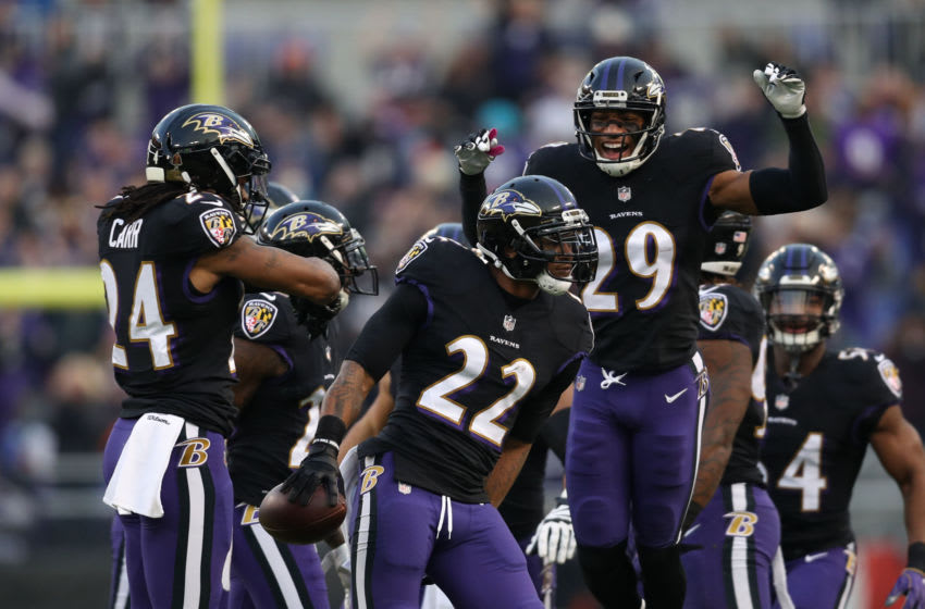 BALTIMORE, MARYLAND - DECEMBER 30: Cornerback Jimmy Smith #22 of the Baltimore Ravens celebrates with teammates after an interception in the first quarter against the Cleveland Browns at M&T Bank Stadium on December 30, 2018 in Baltimore, Maryland. (Photo by Patrick Smith/Getty Images)