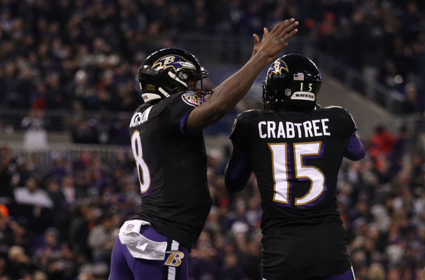 BALTIMORE, MARYLAND - DECEMBER 30: Quarterback Lamar Jackson #8 of the Baltimore Ravens and wide receiver Michael Crabtree #15 celebrate after a touchdown in the second quarter against the Cleveland Browns at M&T Bank Stadium on December 30, 2018 in Baltimore, Maryland. (Photo by Patrick Smith/Getty Images)
