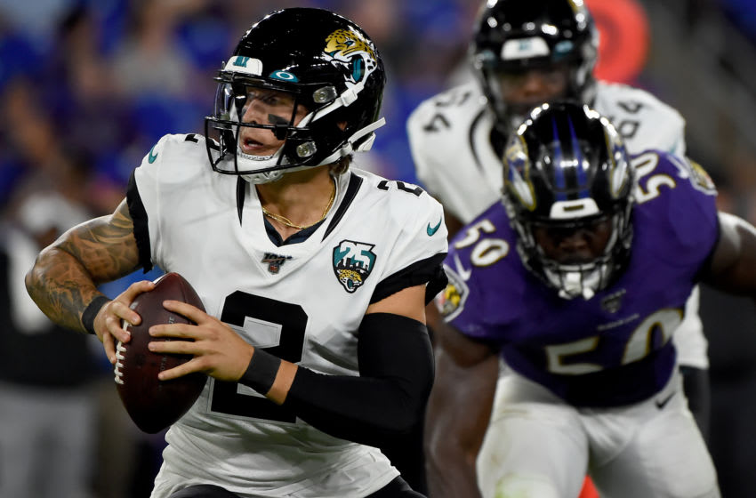 BALTIMORE, MD - AUGUST 08: Alex McGough #2 of the Jacksonville Jaguars is pressured by Otaro Alaka #50 of the Baltimore Ravens during the second half of a preseason game at M&T Bank Stadium on August 8, 2019 in Baltimore, Maryland. (Photo by Will Newton/Getty Images)