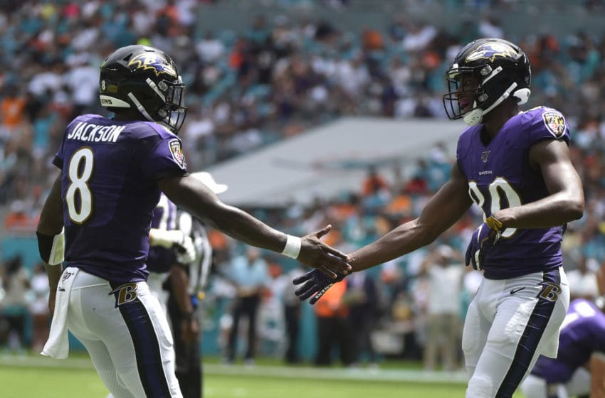 MIAMI, FL - SEPTEMBER 08: Lamar Jackson #8 of the Baltimore Ravens congratulates Miles Boykin #80 after scoring a touchdown in the second quarter against the Miami Dolphins at Hard Rock Stadium on September 8, 2019 in Miami, Florida. (Photo by Eric Espada/Getty Images)
