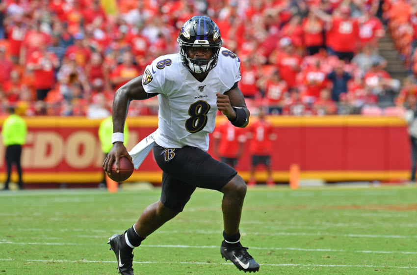 KANSAS CITY, MO - SEPTEMBER 22: Quarterback Lamar Jackson #8 of the Baltimore Ravens scrambles to the outside against the Kansas City Chiefs during the second half at Arrowhead Stadium on September 22, 2019 in Kansas City, Missouri. (Photo by Peter Aiken/Getty Images)