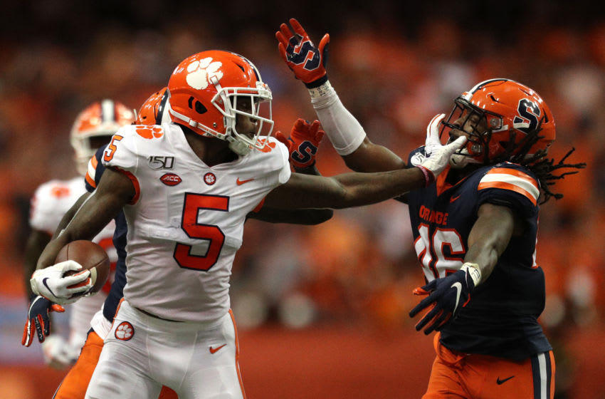 SYRACUSE, NEW YORK - SEPTEMBER 14: Tee Higgins #5 of the Clemson Tigers grabs Lakiem Williams #46 of the Syracuse Orange's face mask during a game at the Carrier Dome on September 14, 2019 in Syracuse, New York. (Photo by Bryan M. Bennett/Getty Images)