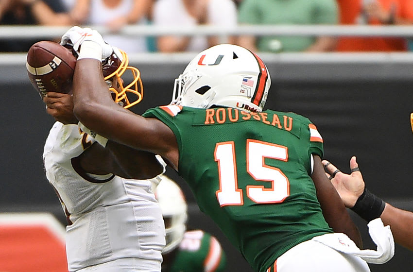 MIAMI, FLORIDA - SEPTEMBER 21: Gregory Rousseau #15 of the Miami Hurricanes sacks David Moore #2 of the Central Michigan Chippewas in the first half against the at Hard Rock Stadium on September 21, 2019 in Miami, Florida. (Photo by Mark Brown/Getty Images)