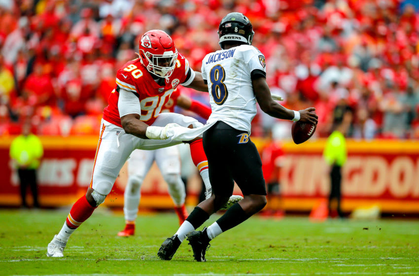 KANSAS CITY, MO - SEPTEMBER 22: Emmanuel Ogbah #90 of the Kansas City Chiefs pressures Lamar Jackson #8 of the Baltimore Ravens at Arrowhead Stadium on September 22, 2019 in Kansas City, Missouri. (Photo by David Eulitt/Getty Images)