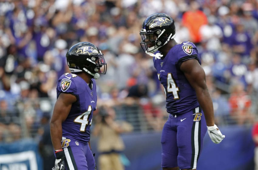 BALTIMORE, MARYLAND - SEPTEMBER 29: Linebacker Tyus Bowser #54 and cornerback Marlon Humphrey #44 of the Baltimore Ravens celebrate after a sack in the first half against the Cleveland Browns at M&T Bank Stadium on September 29, 2019 in Baltimore, Maryland. (Photo by Todd Olszewski/Getty Images)