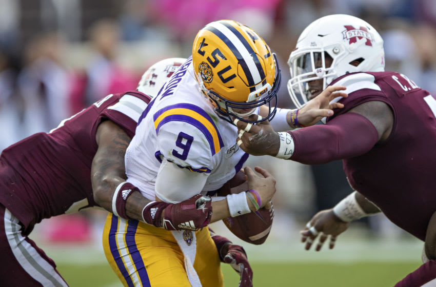 STARKVILLE, MS - OCTOBER 19: Joe Burrow #9 of the LSU Tigers fumbles the ball after being hit by Cameron Dantzler #3 and Chauncey Rivers #5 of the Mississippi State Bulldogs at Davis Wade Stadium on October 19, 2019 in Starkville, Mississippi. The Tigers defeated the Bulldogs 36-13. (Photo by Wesley Hitt/Getty Images)
