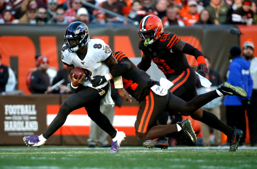 CLEVELAND, OH - DECEMBER 22: Sione Takitaki #44 of the Cleveland Browns attempts to tackle Lamar Jackson #8 of the Baltimore Ravens during the game at FirstEnergy Stadium on December 22, 2019 in Cleveland, Ohio. Baltimore defeated Cleveland 31-15. (Photo by Kirk Irwin/Getty Images)