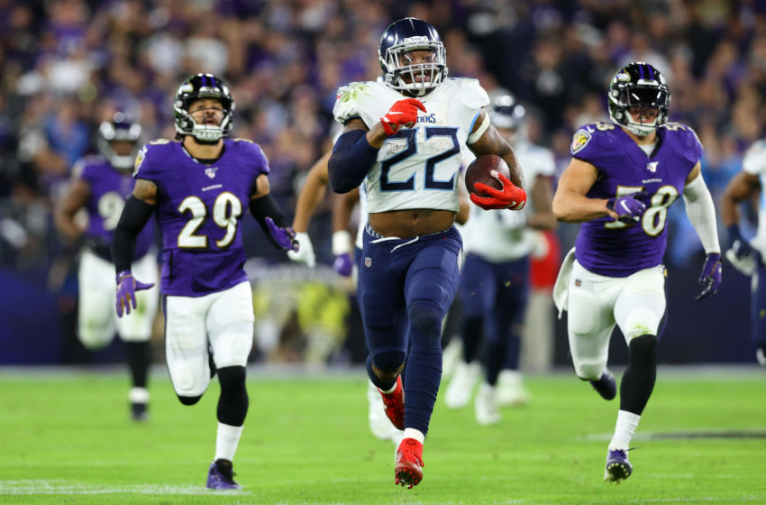 BALTIMORE, MARYLAND - JANUARY 11: Running back Derrick Henry #22 of the Tennessee Titans carries the ball against the Baltimore Ravens during the AFC Divisional Playoff game at M&T Bank Stadium on January 11, 2020 in Baltimore, Maryland. (Photo by Rob Carr/Getty Images)
