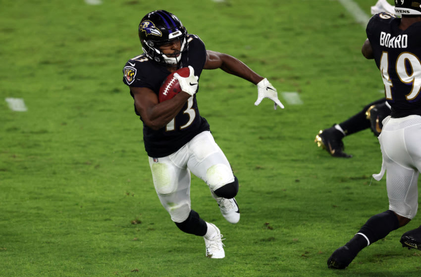 BALTIMORE, MARYLAND - SEPTEMBER 28: Devin Duvernay #13 of the Baltimore Ravens returns a kick off 93 yard to score a touchdown against the Kansas City Chiefs during the second quarter at M&T Bank Stadium on September 28, 2020 in Baltimore, Maryland. (Photo by Rob Carr/Getty Images)