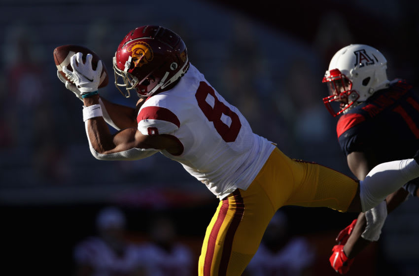 TUCSON, ARIZONA - NOVEMBER 14: Wide receiver Amon-Ra St. Brown #8 of the USC Trojans catches a 48-yard reception against the Arizona Wildcats during the second half of the PAC-12 football game at Arizona Stadium on November 14, 2020 in Tucson, Arizona. The Trojans defeated the Wildcats 34-30. (Photo by Christian Petersen/Getty Images)