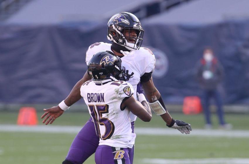 NASHVILLE, TENNESSEE - JANUARY 10: Lamar Jackson #8 of the Baltimore Ravens celebrates with Marquise Brown #15 against the Tennessee Titans in the Wild Card Round of the NFL Playoffs at Nissan Stadium on January 10, 2021 in Nashville, Tennessee. (Photo by Andy Lyons/Getty Images)