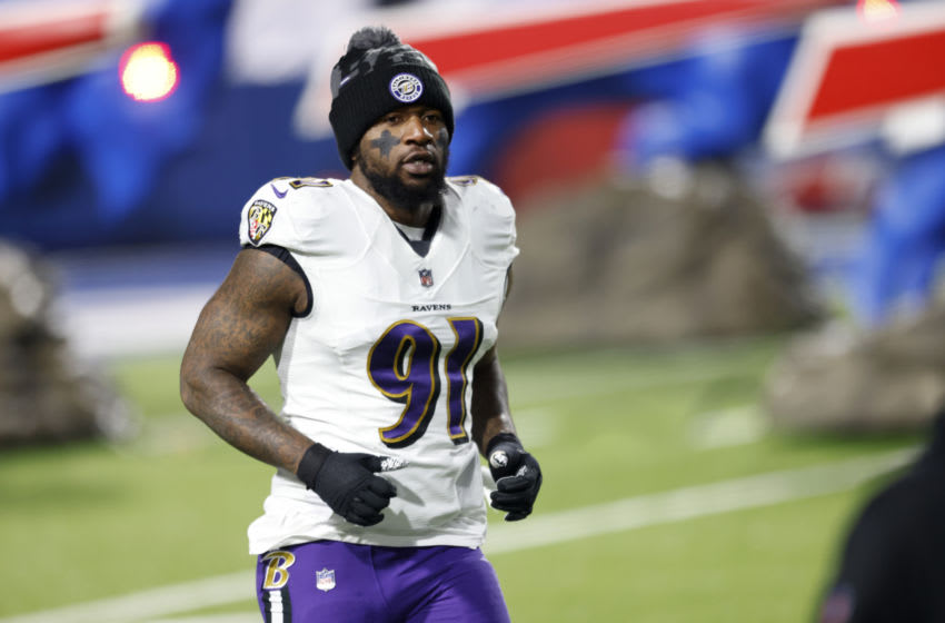 ORCHARD PARK, NEW YORK - JANUARY 16: Yannick Ngakoue #91 of the Baltimore Ravens runs on the field prior to an AFC Divisional Playoff game against the Buffalo Bills at Bills Stadium on January 16, 2021 in Orchard Park, New York. (Photo by Bryan Bennett/Getty Images)