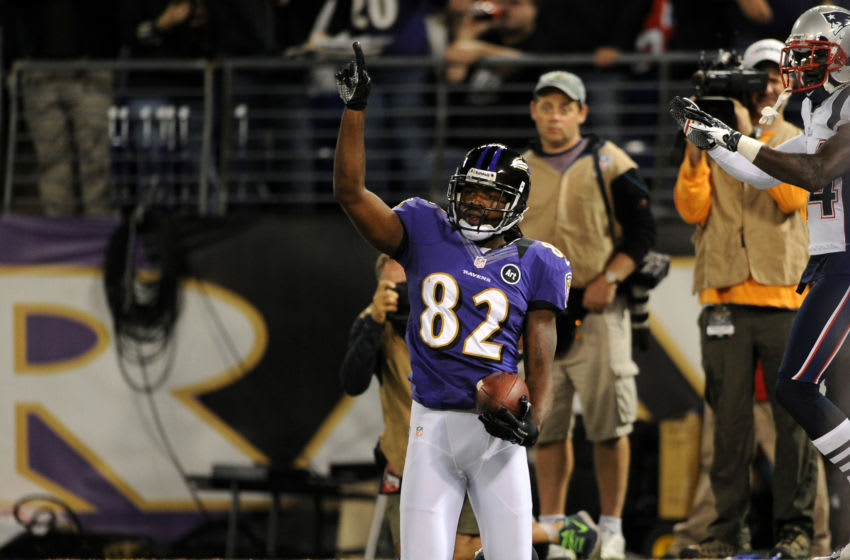 BALTIMORE, MD - SEPTEMBER 23: Torrey Smith #82 of the Baltimore Ravens celebrates after he scored a 25-yard touchdown recpetion in the second quarter against the New England Patriots at M&T Bank Stadium on September 23, 2012 in Baltimore, Maryland. (Photo by Patrick Smith/Getty Images)