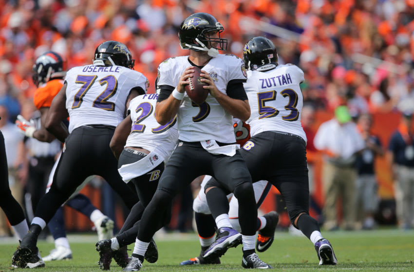 DENVER, CO - SEPTEMBER 13: Quarterback Joe Flacco #5 of the Baltimore Ravens looks to pass against the Denver Broncos in the second quarter of a game at Sports Authority Field at Mile High on September 13, 2015 in Denver, Colorado. (Photo by Doug Pensinger/Getty Images)