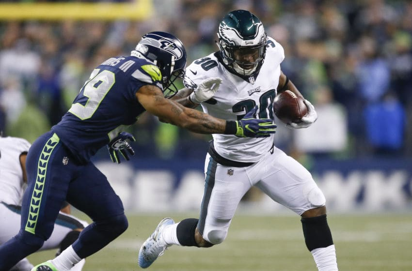 SEATTLE, WA - DECEMBER 03: running back Corey Clement #30 of the Philadelphia Eagles rushes against free safety Earl Thomas #29 of the Seattle Seahawks in the second quarter at CenturyLink Field on December 3, 2017 in Seattle, Washington. (Photo by Otto Greule Jr /Getty Images)