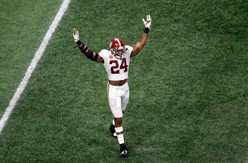 ATLANTA, GA - JANUARY 08: Terrell Lewis #24 of the Alabama Crimson Tide celebrates beating the Georgia Bulldogs in overtime and winning the CFP National Championship presented by AT&T at Mercedes-Benz Stadium on January 8, 2018 in Atlanta, Georgia. Alabama won 26-23. (Photo by Mike Zarrilli/Getty Images)