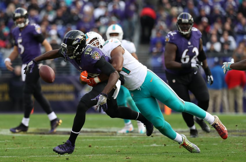 BALTIMORE, MD - DECEMBER 4: Defensive end Cameron Wake #91 of the Miami Dolphins breaks up a pass intended for wide receiver Breshad Perriman #18 of the Baltimore Ravens in the third quarter at M&T Bank Stadium on December 4, 2016 in Baltimore, Maryland. (Photo by Rob Carr/Getty Images)