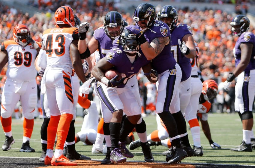 CINCINNATI, OH - SEPTEMBER 10: Terrance West #28 of the Baltimore Ravens is congratulated by his teammates after scoring a touchdown during the second quarter of the game against the Cincinnati Bengals at Paul Brown Stadium on September 10, 2017 in Cincinnati, Ohio. (Photo by Michael Reaves/Getty Images)