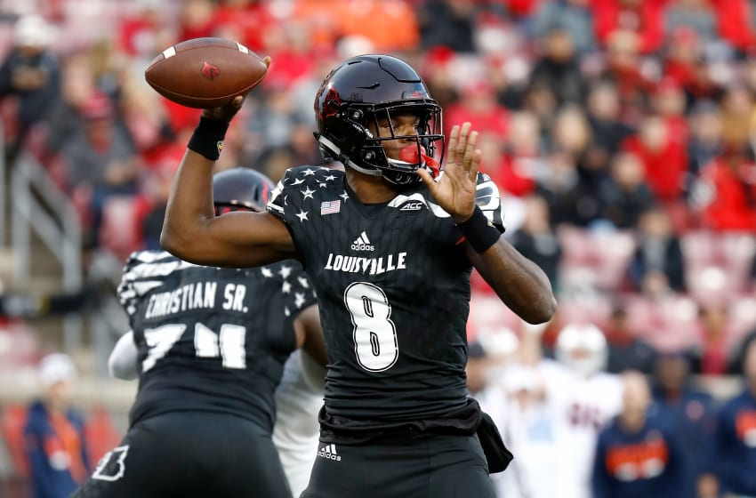 LOUISVILLE, KY - NOVEMBER 11: Lamar Jackson #8 of the Louisville Cardinals throws a pass against the Virginia Cavaliers at Papa John's Cardinal Stadium on November 11, 2017 in Louisville, Kentucky. (Photo by Andy Lyons/Getty Images)