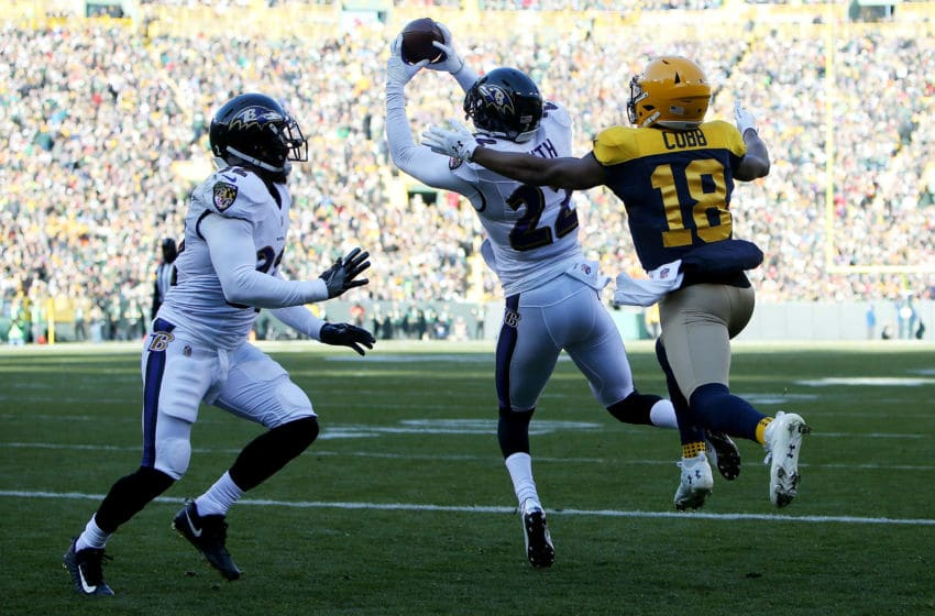 GREEN BAY, WI - NOVEMBER 19: Jimmy Smith #22 of the Baltimore Ravens makes an interception in front of Randall Cobb #18 of the Green Bay Packers in the first quarter at Lambeau Field on November 19, 2017 in Green Bay, Wisconsin. (Photo by Dylan Buell/Getty Images)