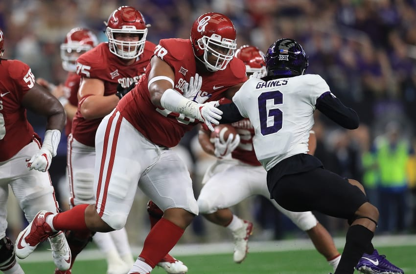 ARLINGTON, TX - DECEMBER 02: Orlando Brown #78 of the Oklahoma Sooners blocks Innis Gaines #6 of the TCU Horned Frogs in the third quarter during Big 12 Championship at AT&T Stadium on December 2, 2017 in Arlington, Texas. (Photo by Ronald Martinez/Getty Images)