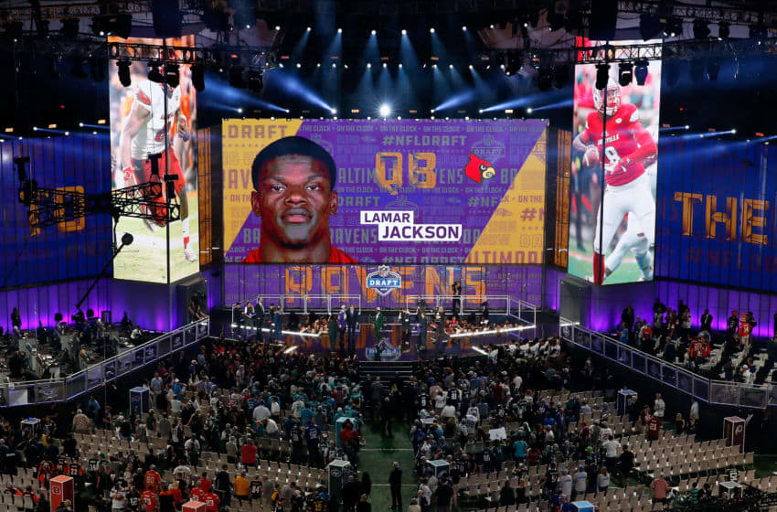 ARLINGTON, TX - APRIL 26: A video board displays an image of Lamar Jackson of Louisville after he was picked #32 overall by the Baltimore Ravens during the first round of the 2018 NFL Draft at AT&T Stadium on April 26, 2018 in Arlington, Texas. (Photo by Tim Warner/Getty Images)