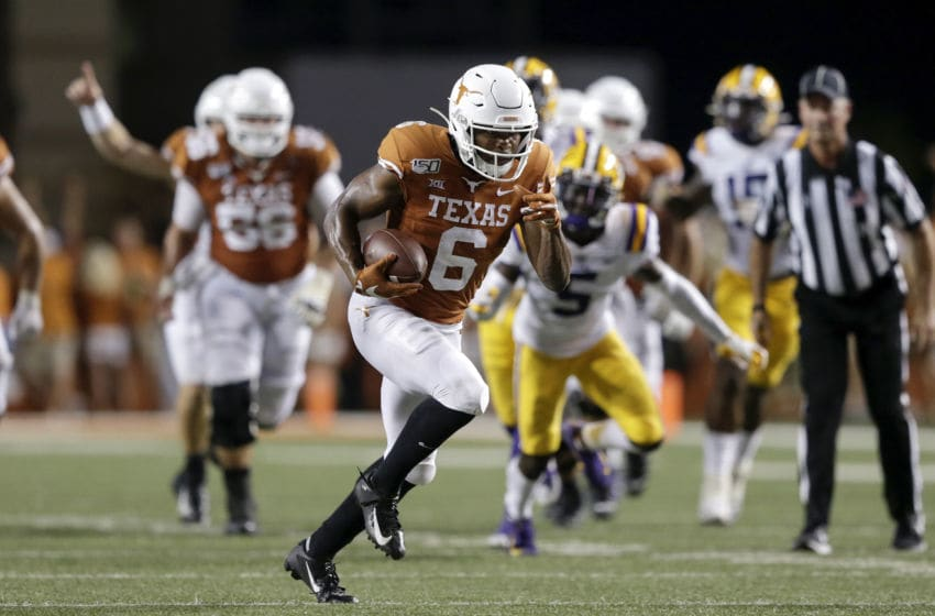 AUSTIN, TX - SEPTEMBER 07: Devin Duvernay #6 of the Texas Longhorns runs for a touchdown after a reception in the second half against the LSU Tigers at Darrell K Royal-Texas Memorial Stadium on September 7, 2019 in Austin, Texas. (Photo by Tim Warner/Getty Images)