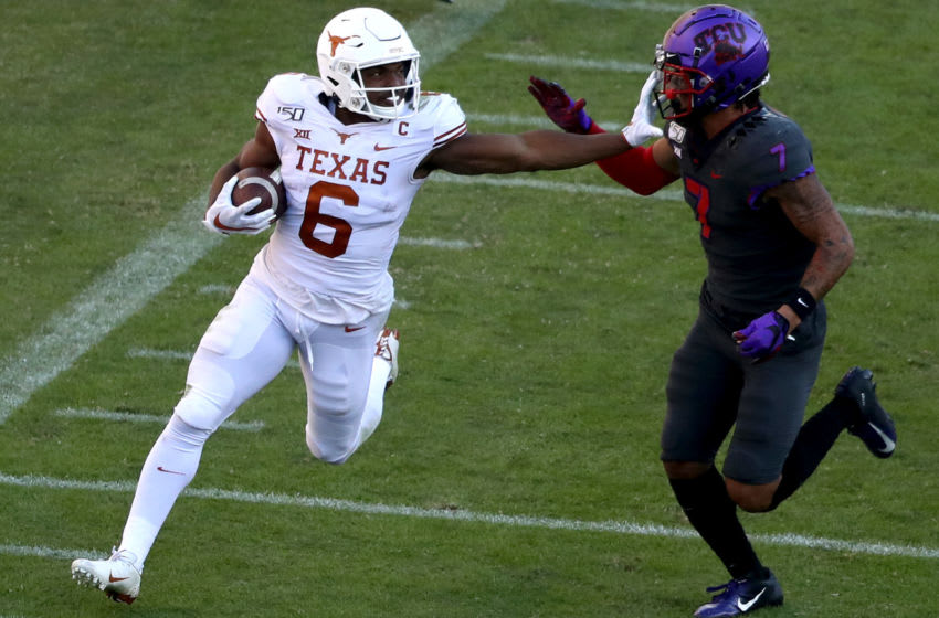 FORT WORTH, TEXAS - OCTOBER 26: Devin Duvernay #6 of the Texas Longhorns runs the ball against Trevon Moehrig #7 of the TCU Horned Frogs in the second half at Amon G. Carter Stadium on October 26, 2019 in Fort Worth, Texas. (Photo by Ronald Martinez/Getty Images)