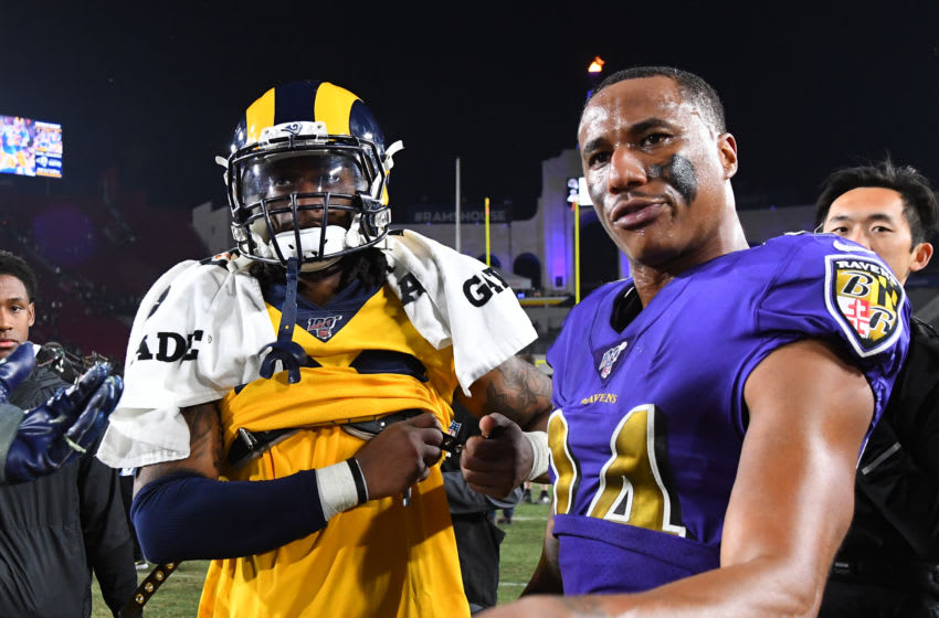 LOS ANGELES, CA - NOVEMBER 25: Todd Gurley #30 of the Los Angeles Rams and Marcus Peters #24 of the Baltimore Ravens exchange jerseys after the game at the Los Angeles Memorial Coliseum on November 25, 2019 in Los Angeles, California. (Photo by Jayne Kamin-Oncea/Getty Images)