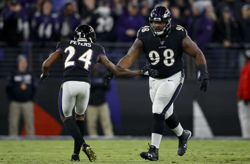 BALTIMORE, MD - NOVEMBER 03: Marcus Peters #24 of the Baltimore Ravens celebrates with Brandon Williams #98 during the first half against the New England Patriots at M&T Bank Stadium on November 3, 2019 in Baltimore, Maryland. (Photo by Scott Taetsch/Getty Images)