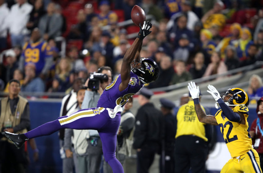 LOS ANGELES, CALIFORNIA - NOVEMBER 25: Miles Boykin #80 of the Baltimore Ravens makes a reception over the defense of Troy Hill #22 of the Los Angeles Rams during the second half of a game at Los Angeles Memorial Coliseum on November 25, 2019 in Los Angeles, California. (Photo by Sean M. Haffey/Getty Images)