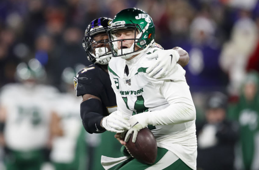BALTIMORE, MD - DECEMBER 12: Tyus Bowser #54 of the Baltimore Ravens causes Sam Darnold #14 of the New York Jets to fumble the ball during the second half at M&T Bank Stadium on December 12, 2019 in Baltimore, Maryland. (Photo by Scott Taetsch/Getty Images)