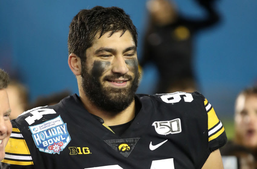 SAN DIEGO, CALIFORNIA - DECEMBER 27: A.J. Epenesa #94 of the Iowa Hawkeyes celebrates after being named the defensive player of the game after defeating the USC Trojans 49-24 in the San Diego County Credit Union Holiday Bowl at SDCCU Stadium on December 27, 2019 in San Diego, California. (Photo by Sean M. Haffey/Getty Images)