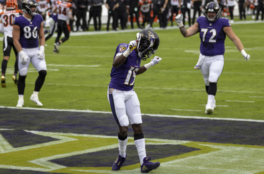 BALTIMORE, MD - OCTOBER 11: Marquise Brown #15 of the Baltimore Ravens celebrates after scoring a touchdown against the Cincinnati Bengals during the first half at M&T Bank Stadium on October 11, 2020 in Baltimore, Maryland. (Photo by Scott Taetsch/Getty Images)